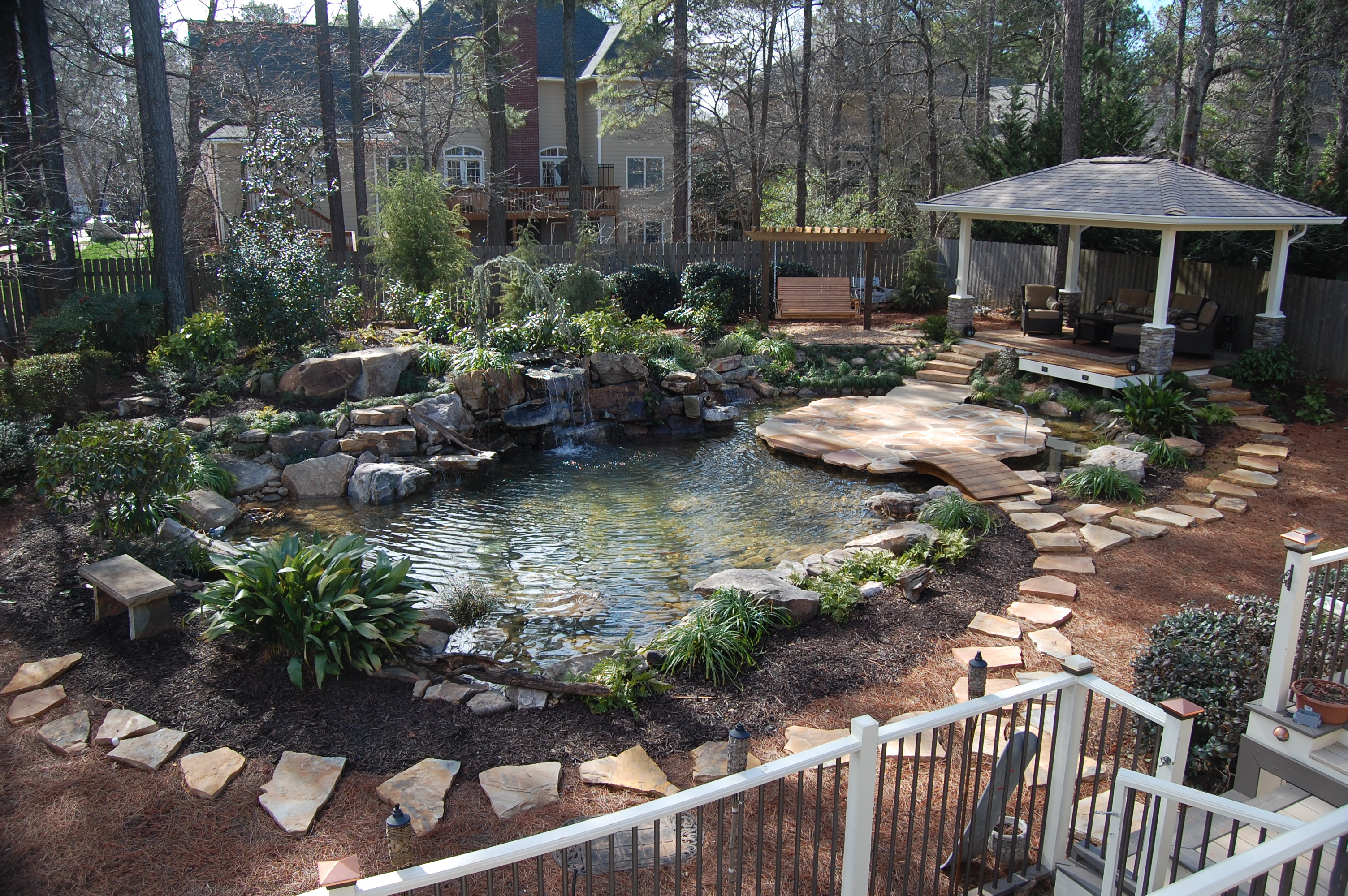 Make your water gardens with trendy pond designs for Water garden designs