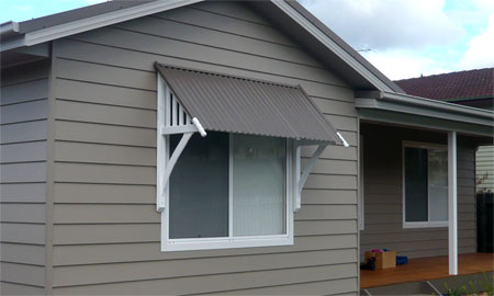 Protect your home with window awnings carehomedecor for Pictures of awning windows