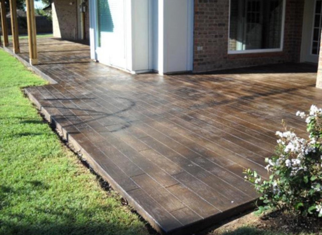 Give a new touch to house by adoring stained concrete patio