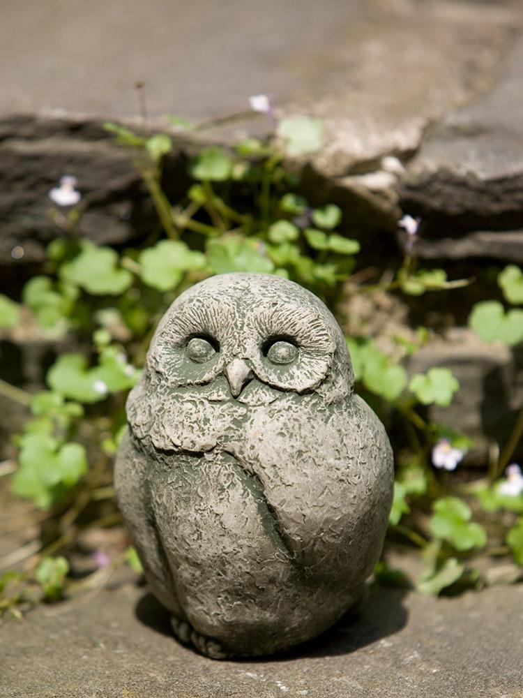Use different kinds of stone garden ornaments