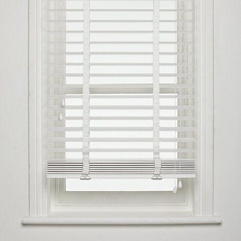 white wooden venetian blinds  26