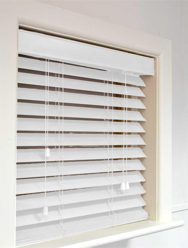 white wooden venetian blinds  71