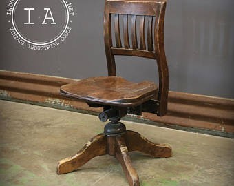 Antique swivel chair | Etsy