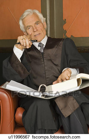 Picture of Portrait of a lawyer sitting in an armchair with a file