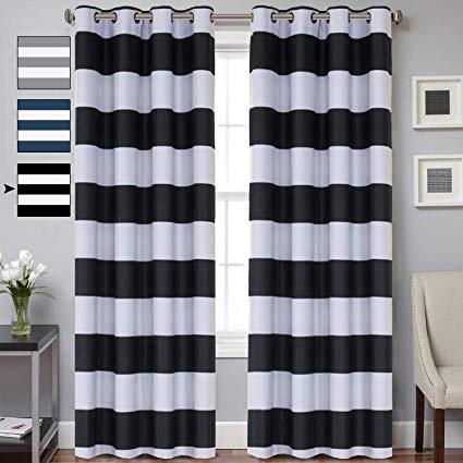 Peak of interior designing:   black and white curtains