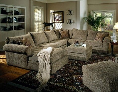 big super comfy sectional couch where both ottomans would fit in the
