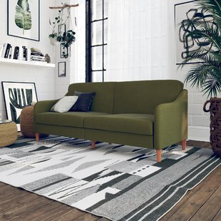Have a dark green sofa that   doesn't work? try pillows!