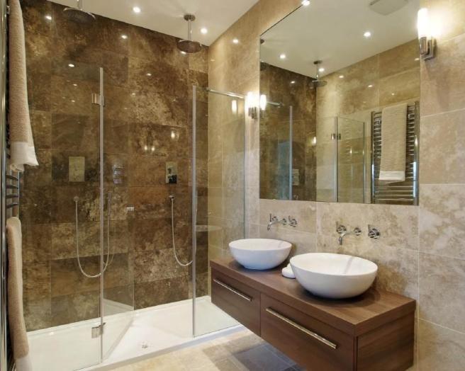 photo of beige brown bathroom ensuite ensuite bathroom with cabinets
