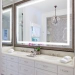 An unconventional way to   decorate your bathroom using a large bathroom mirror