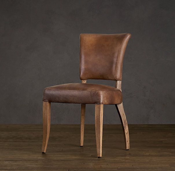 I think leather dining chairs might be interesting if the table was