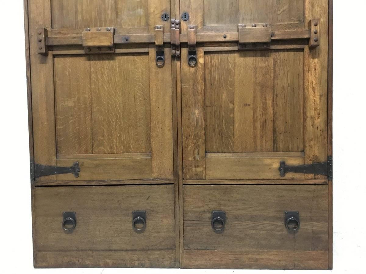 Wylie and Lochhead. A Large Arts and Crafts Oak Wardrobe With