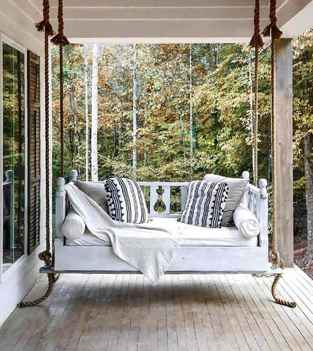 The best front porch swing styled beautifully with gorgeous textiles