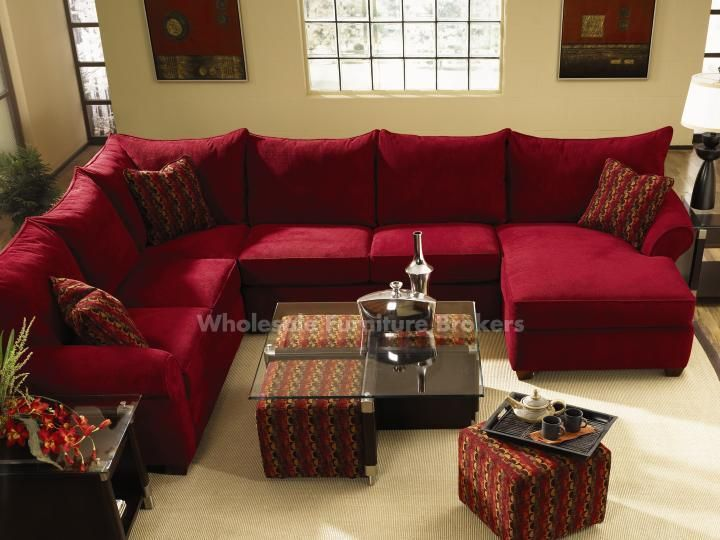 Diggin' the red sectional and the coffee table with the pull-out