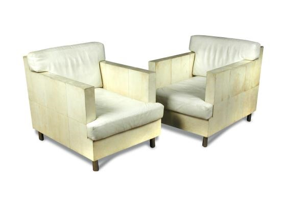 A pair of cream vellum and white leather armchairs by Ria and Youri