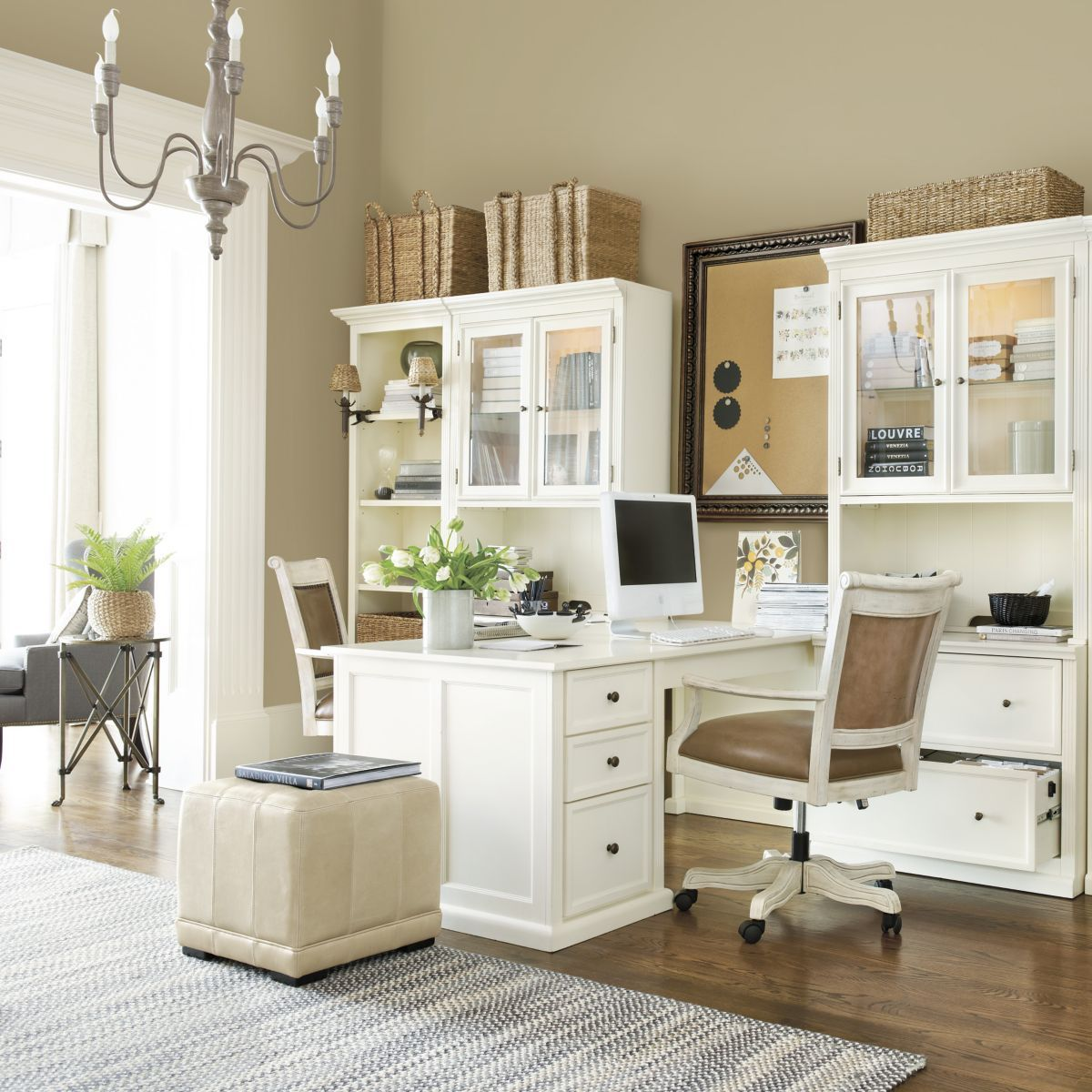 White and airy home office. Like the way the desks bump out so 2 people can  work in a small space.