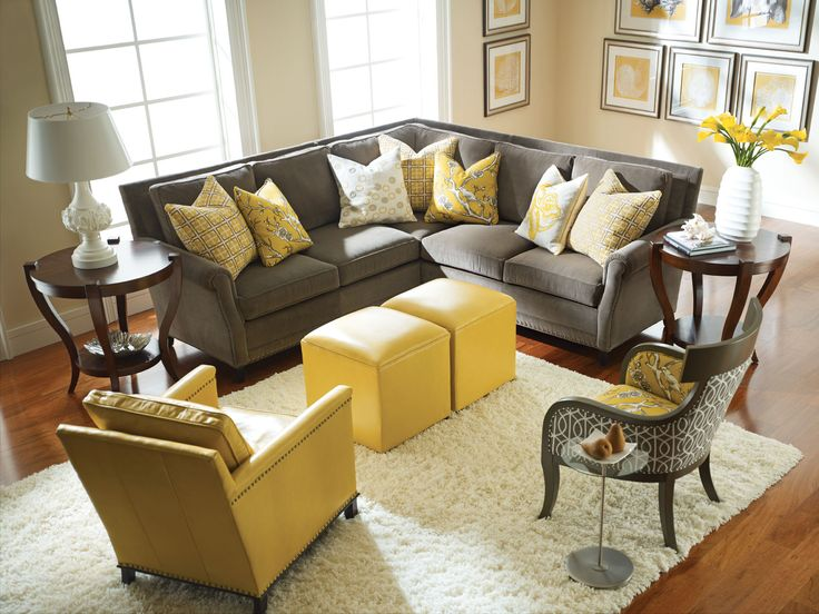 Enhance your living room with   yellow and grey chairs
