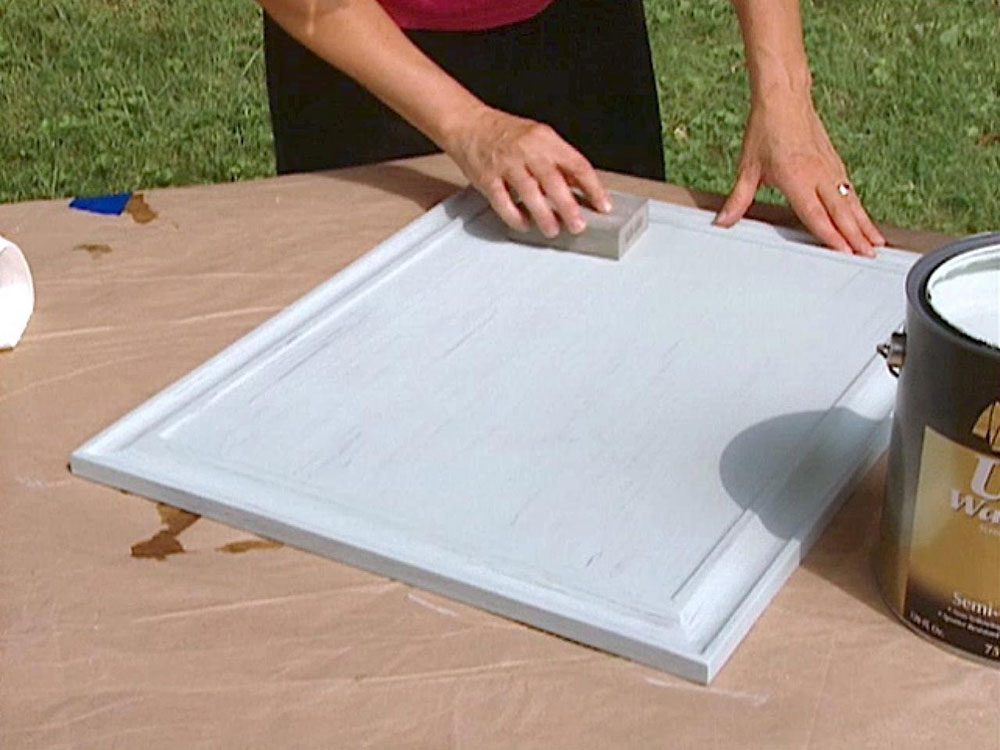 sanding again How to paint laminate kitchen cabinets (a quick guide)