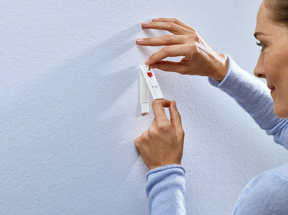 self-adhesive1 How to hang pictures on plaster walls and let them stick there