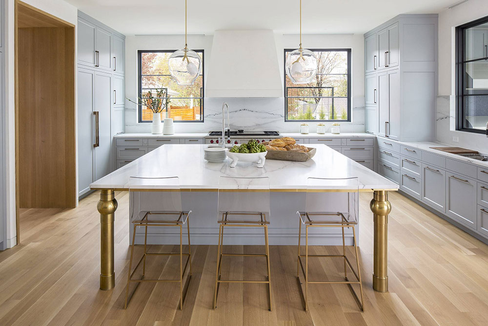 Acrylic-and-brass-on-island-with-brass-legs-from-Boss-Design-Center How to decorate a kitchen island (Cool Ideas and Designs)