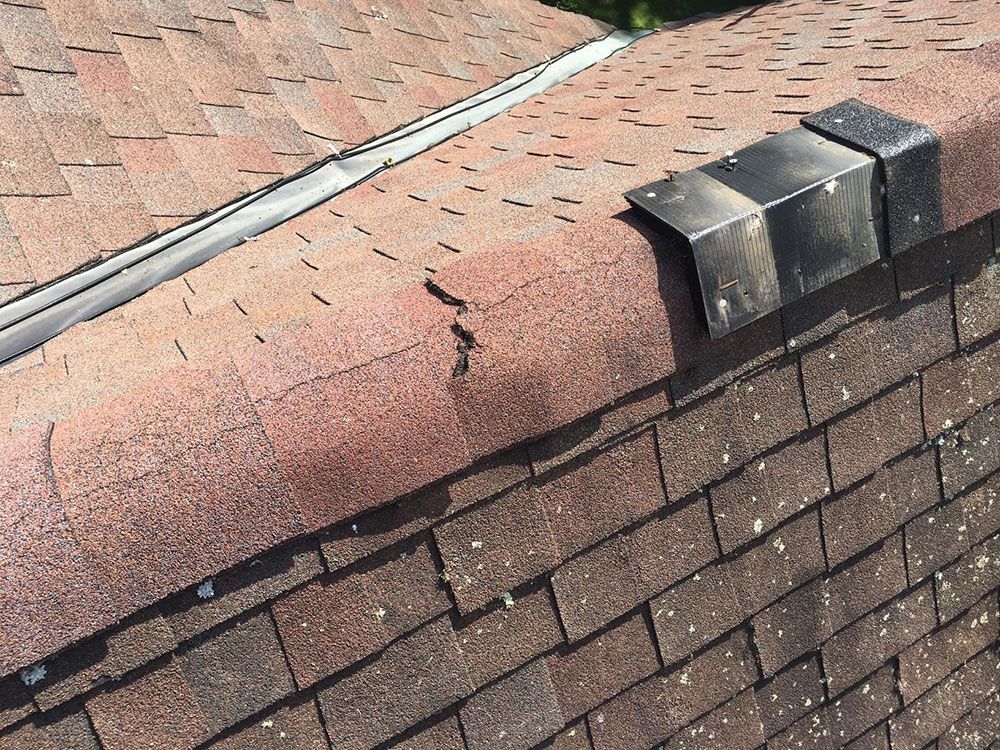 cracked How long do asphalt shingles last and when should you change them?