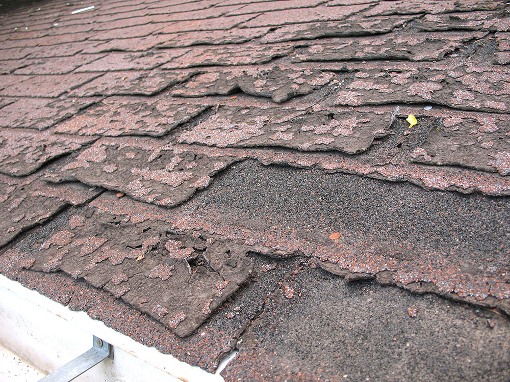 broken shingles1 How long does asphalt shingles last and when should you change them?