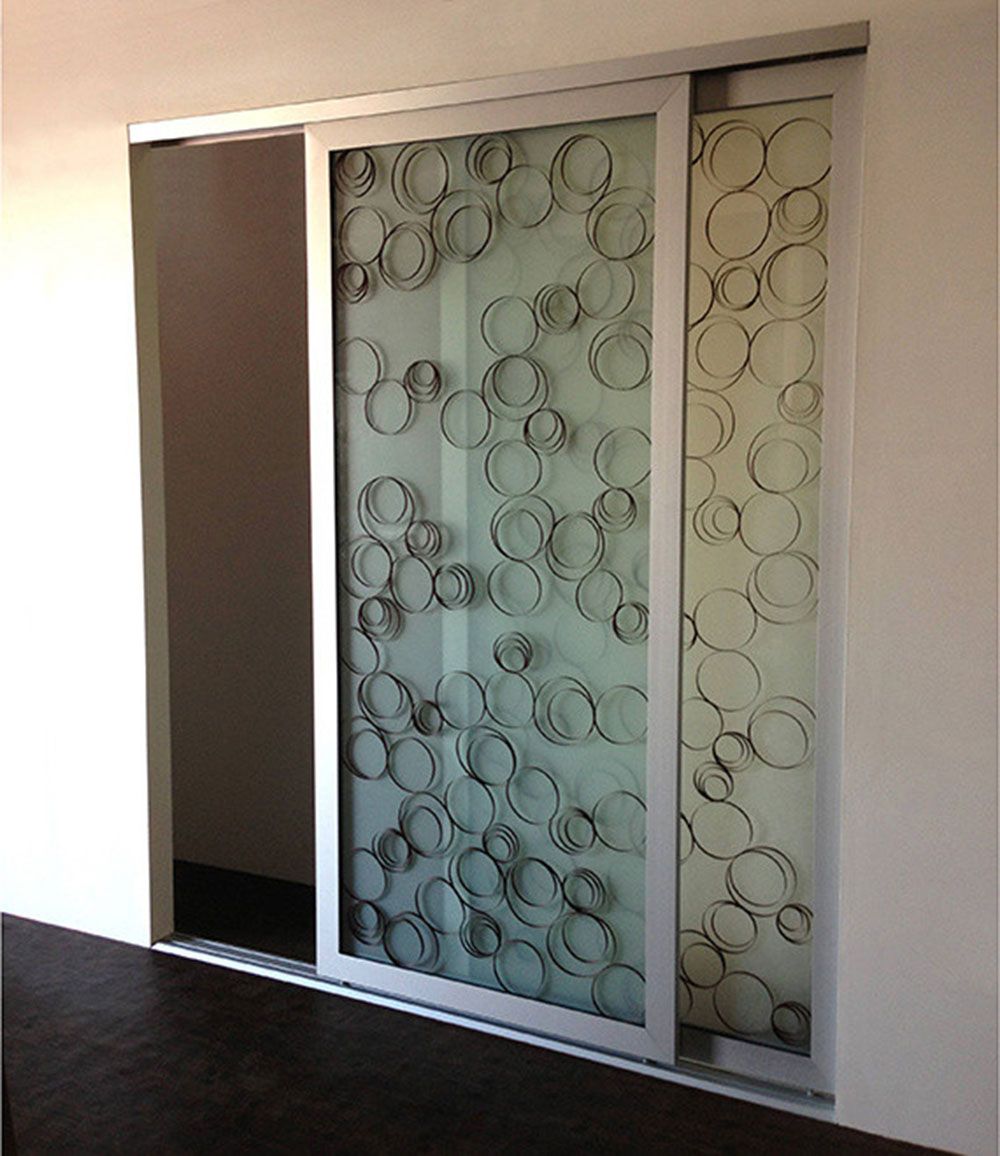 Ellipses-wooden rings-sliding wardrobe-doors-room dividers-opening-closing-doors How to cover a wardrobe without doors (inexpensive options)