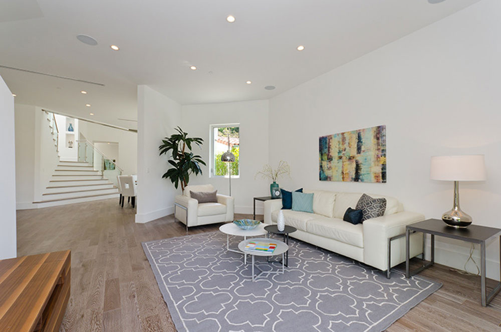 Open-Space-Living-Room-by-Diditan-Group-Inc How to have a minimalist decor in your home without clutter
