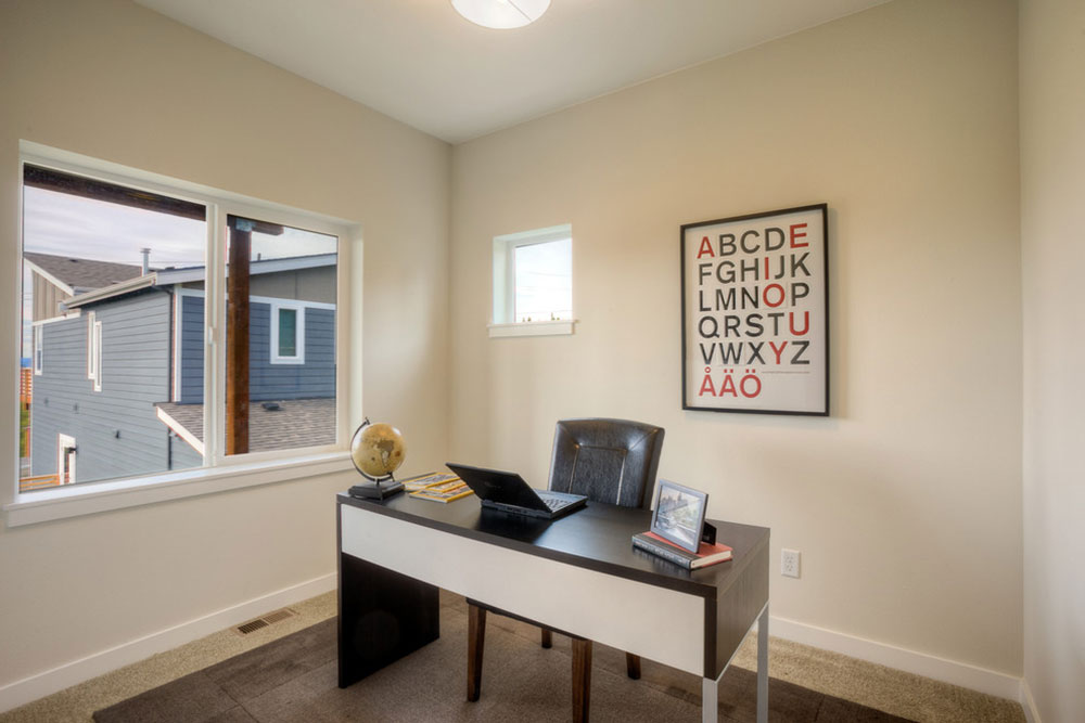 Bonus-room-and-office-with-a-big-window-with-a-view-Puget-Sound-by-Powell-Homes-Renovations Bonus-room-ideas and what to do with extra space in your home
