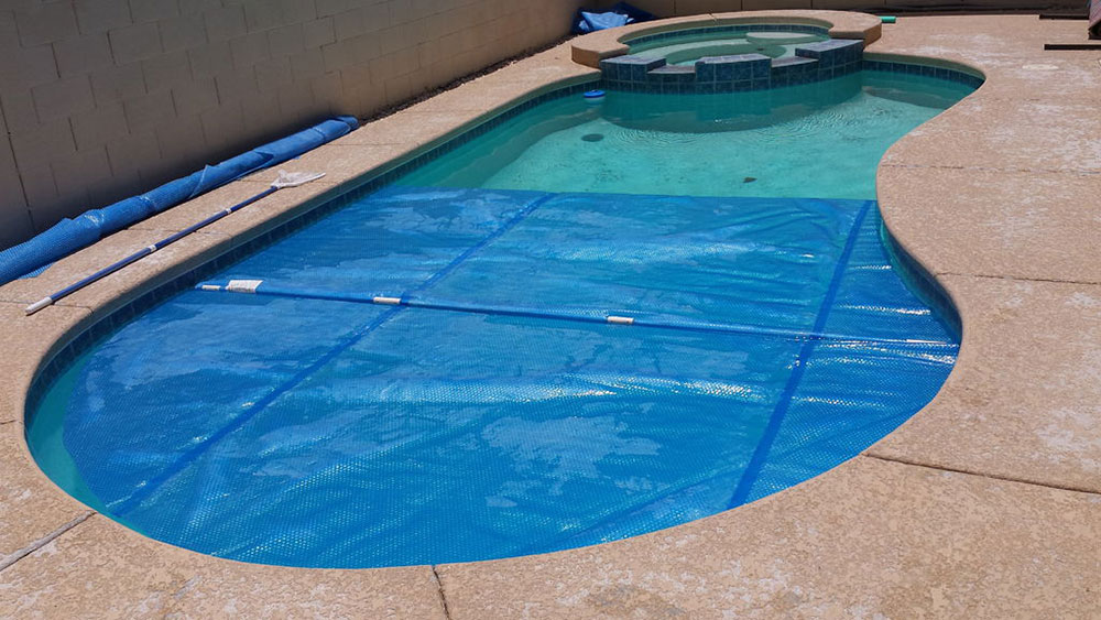 Solar cover How to heat a swimming pool for free (well, almost free)