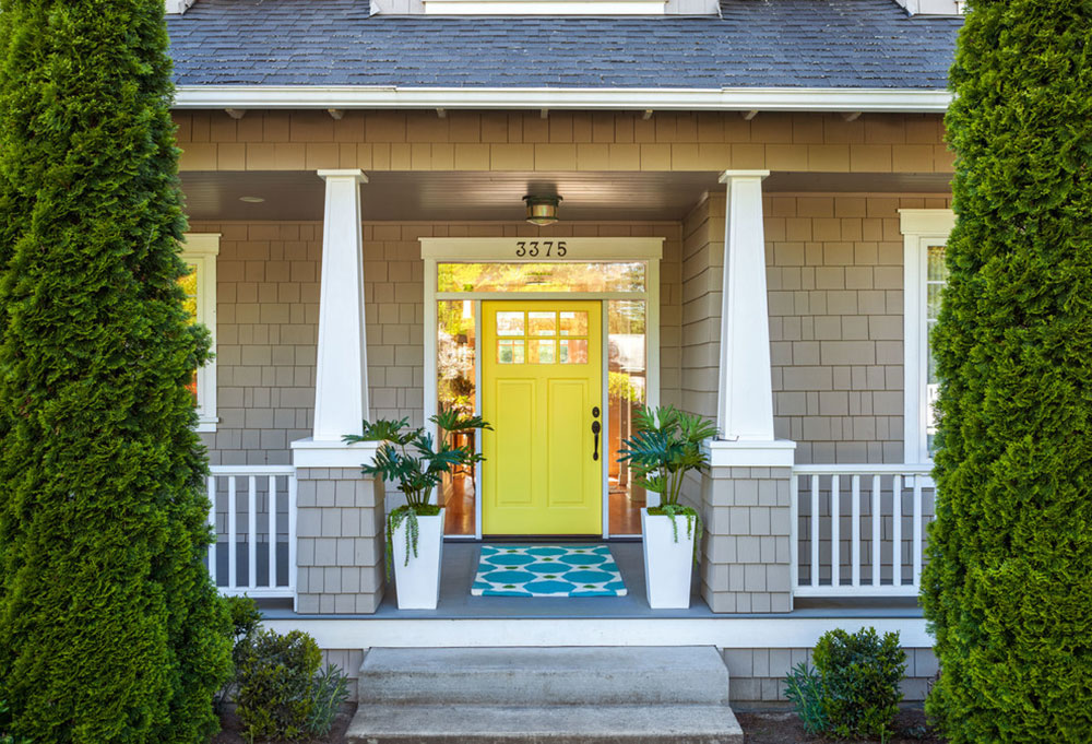 Craftsman-Cottage-Entry-by-Garrison-Hullinger-Interior-Design-Inc Yellow front door ideas for a lively house entrance
