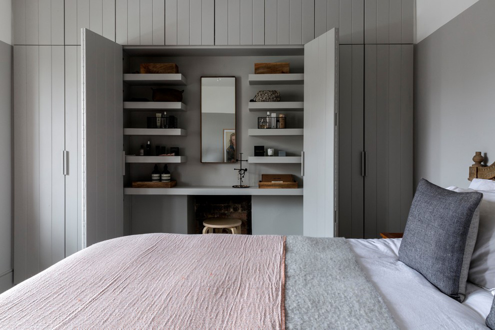 Transitional-Bedroom-by-Allandnxthing Storage ideas for bedrooms to optimize your space