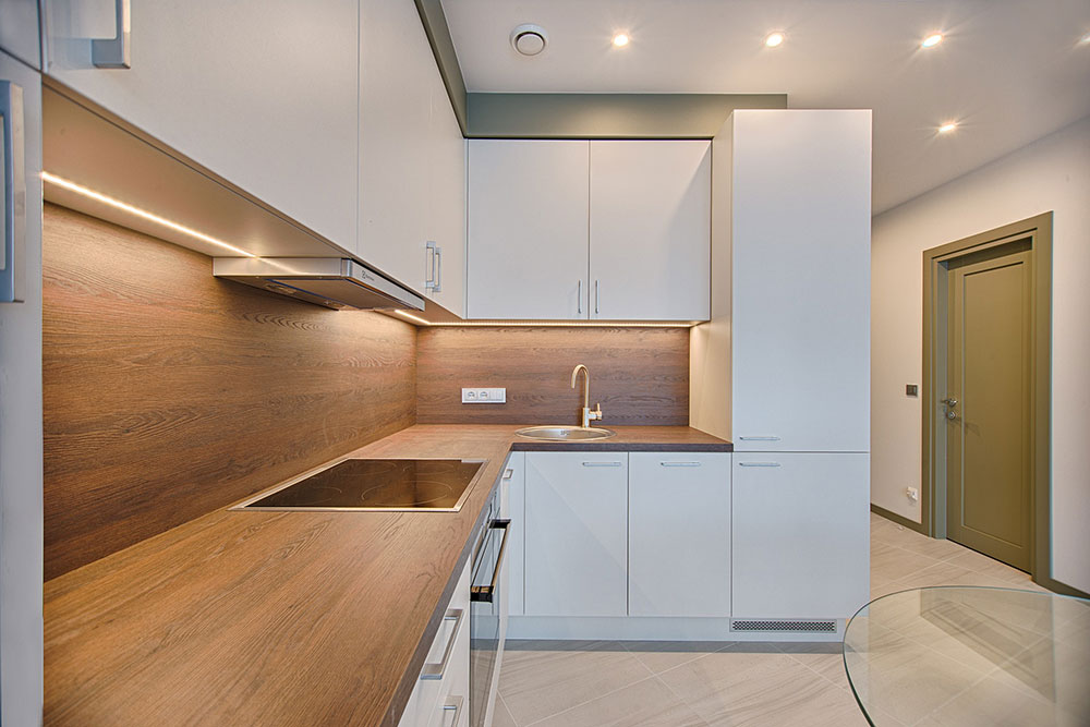 white-wood-modular-kitchen-1643384 The advantages of hiring a luxury interior designer for your home