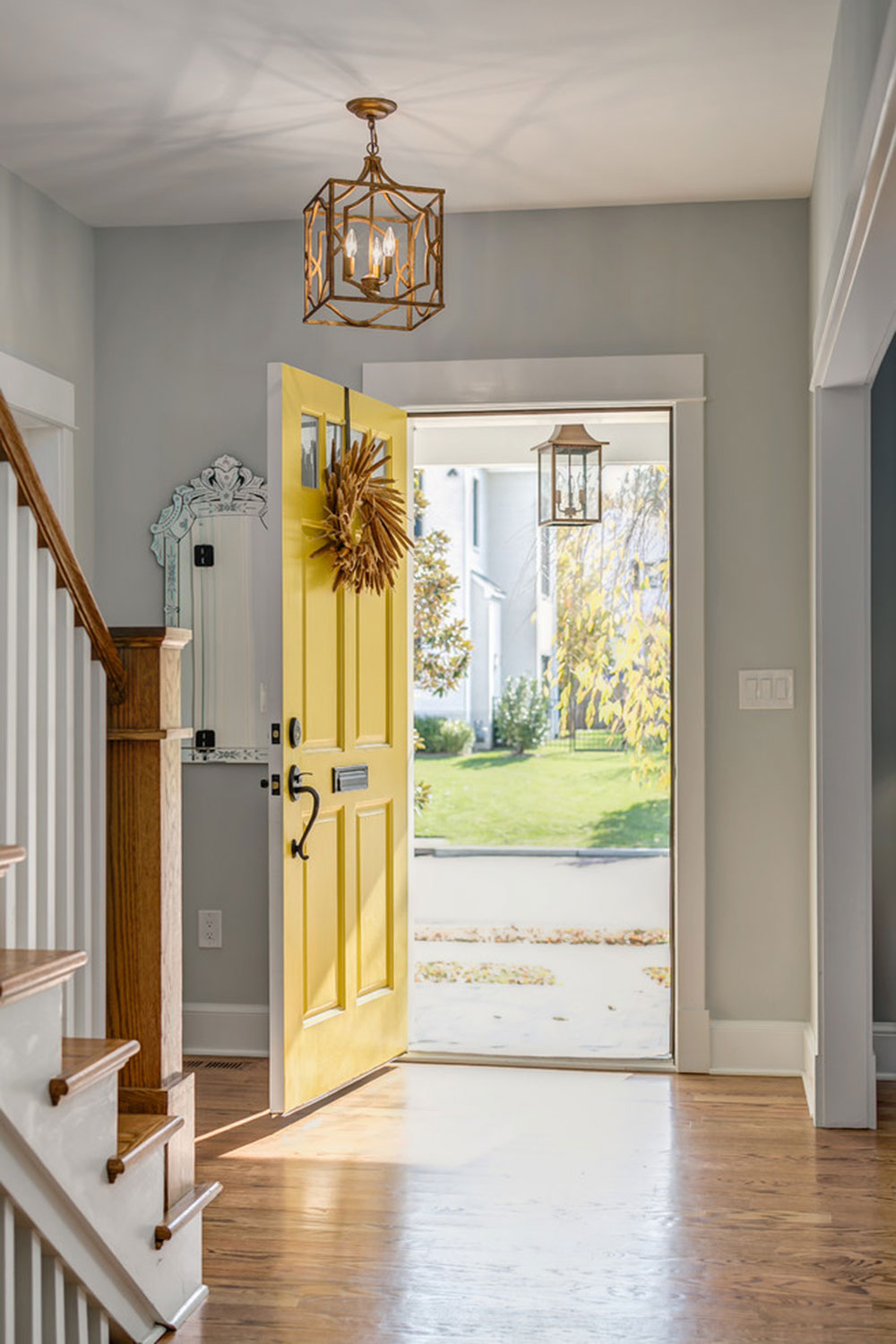 Cape-Cod-Charm-by-Moser-Architects-PLLC Yellow front door ideas for a lively house entrance