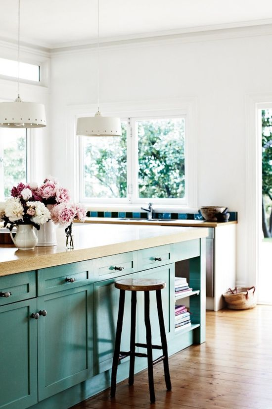 The kitchen cupboards were painted with old paint the owner found .