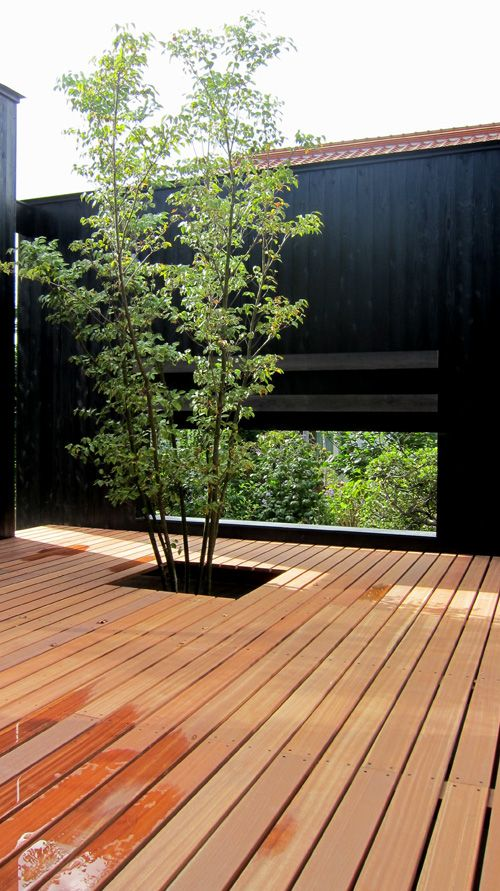 Gorgeous way to incorporate existing trees into a new deck .