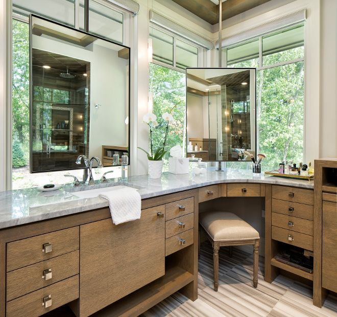 Bathroom with corner vanity and mirror in front of window | Hendel .