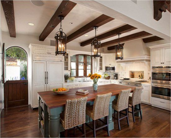 Spanish Style Kitchens | Iron lantern pendants are perfect for a .