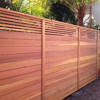 Custom horizontal fence with picket accent top.. Stained natural .