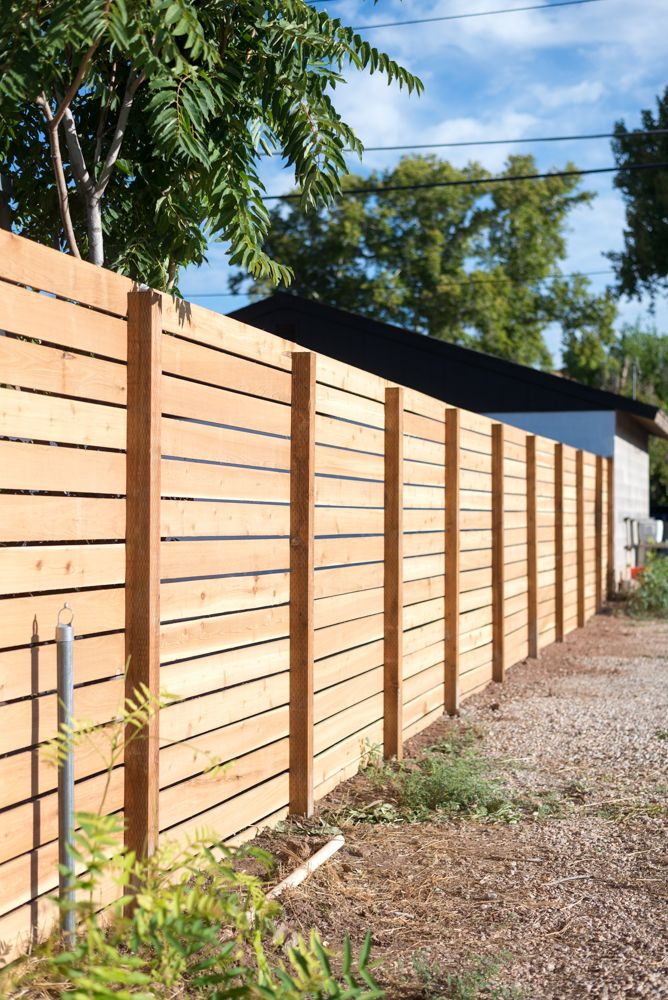 Horizontal wooden fence ideas that look   stunning